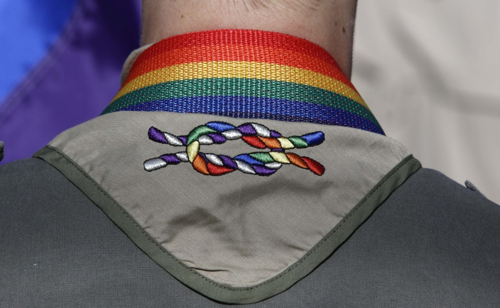 A Boy Scout wears his kerchief embroidered with a rainbow knot during Salt Lake City's 2014 gay pride parade. The Boy Scouts of America's top policy-making board voted Monday to end its blanket ban on gay adult leaders while allowing church-sponsored Scout units to maintain the exclusion.