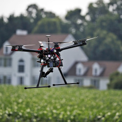 A hexacopter drone is flown by Intelligent UAS at a farm and winery in Cordova, Md., to demonstrate its agriculture potential for board members of the National Corn Growers. The Associated Press