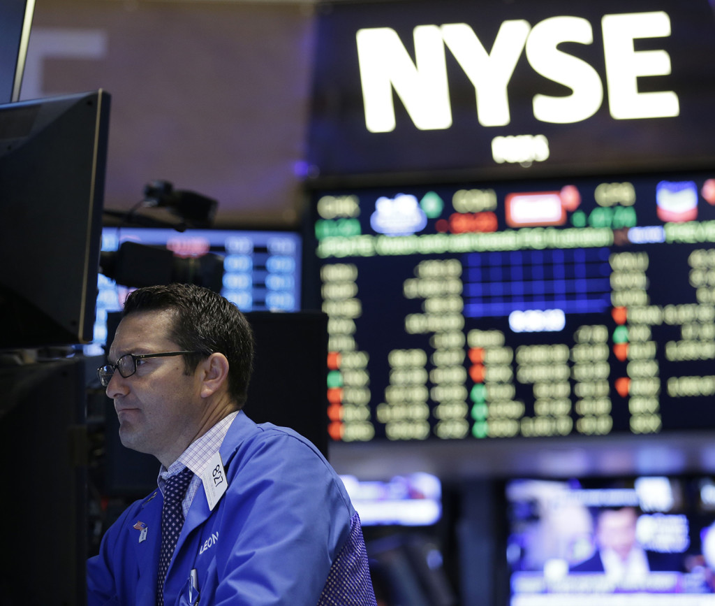 Traders work on the floor at the New York Stock Exchange in New York, Wednesday. The Associated Press