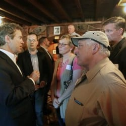 Republican presidential candidate Sen. Rand Paul, R-Ky., speaks with voters during a campaign stop the Snow Shoe Club on June 6 in Concord, N.H.  Paul is campaigning in the nation's earliest  presidential primary state.