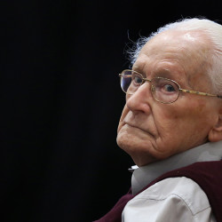 Former SS officer Oskar Groening, 94, sits in the courtroom in Lueneburg, Germany. Groening is charged with 300,000 counts of accessory to murder on allegations he helped the Auschwitz nazi death camp function by sorting cash and valuables seized from Jews.