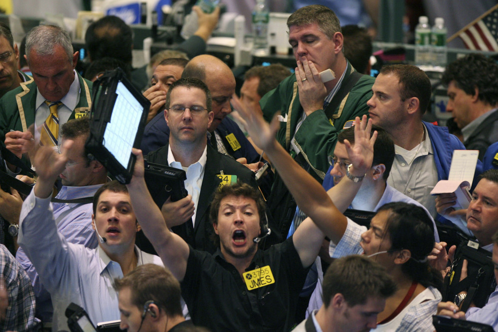 Crude oil options traders work on the floor of the New York Mercantile Exchange in New York in 2007. Most pits in Chicago and New York where traders bet on future prices of palladium and gold, cattle and corn and dozens of other commodities closed for good Monday.