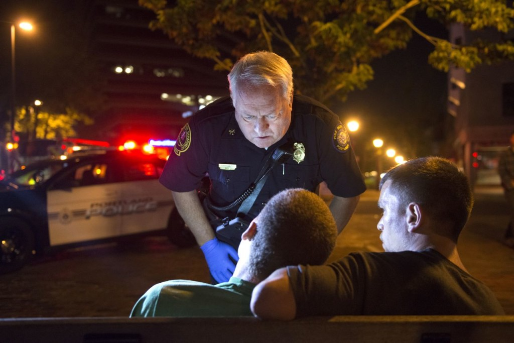 """Portland Deputy Fire Chief Terry Walsh responds to a possible heroin overdose by an 18-year-old male.  Over the years, calls of overdoses and related """"cardiac arrest"""" calls have increased and become routine in the city.  Washington Post photo by Linda Davidson"""