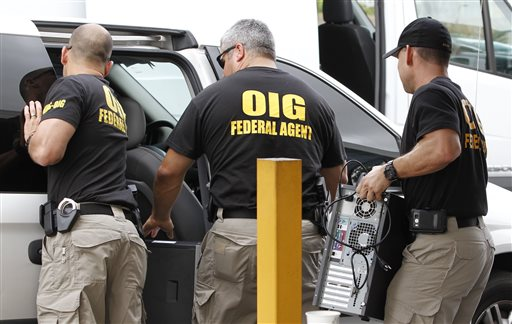 "Federal agents with the Office of Inspector General load computers seized from Willsand Home Health Agency Inc. into a van in Miami. Since 2007, nine regional ""strike forces"" of the Justice, Treasury and Health and Human Services departments have charged about 2,300 people who had falsely billed Medicare for $7 billion. The Associated Press"