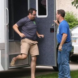 Subway restaurant spokesman Jared Fogle leaves a police vehicle outside of his home Tuesday in Zionsville, Ind. Charlie Nye/The Indianapolis Star via AP