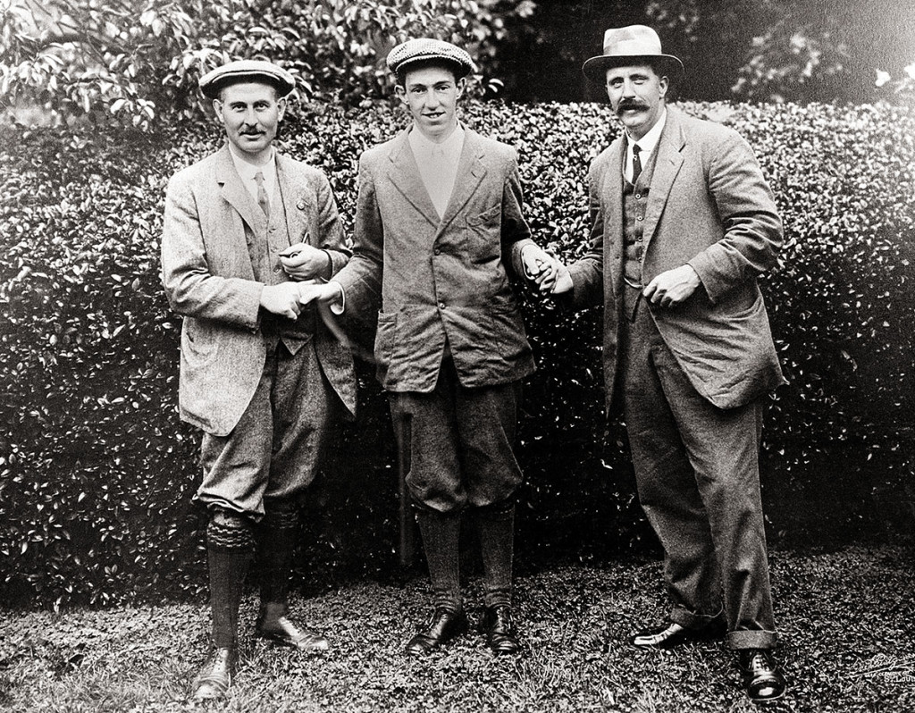 In this 1913 photo, American golfer Francis D. Ouimet, center, shakes hands with Harry Vardon, left, and Ted Ray, both of Britain, at the U.S. Open golf tournament at The Country Club in Brookline, Mass. The Country Club is where Ouimet won a playoff over Vardon and Ray. The upset put golf on the front pages of newspapers.
