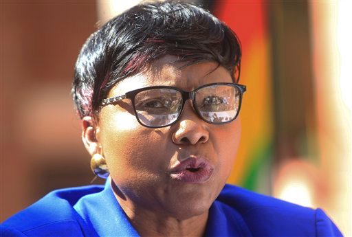 """Oppah Muchinguri, the Zimbabwean minister of  environment, water and climate, addresses a  press conference in Harare Friday. """"We are appealing to the responsible authorities for (Walter Palmer's) extradition to Zimbabwe so that he be made accountable.""""  The Associated Press"""