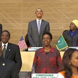 President Barack Obama, flanked by Ethiopia's Prime Minister Hailemariam Desalegn, top left, and African Union Chairwoman Nkosazana Dlamini-Zuma, arrives to deliver remarks at the African Union in Addis Ababa, Ethiopia, Tuesday. Reuters