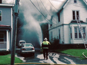 Waterville Fire Chief Dave LaFountain approaches 48 Silver St. as departments from Waterville and Winslow battled a two-alarm fire Wednesday afternoon.