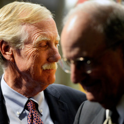 U.S. Sen. Angus King, left, and former Sen. George Mitchell wait to be introduced at the University of Southern Maine in Portland where they participated in a forum discussion about the Iran nuclear deal Wednesday.