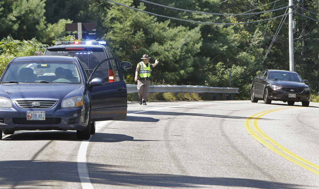 A Cumberland County sheriff's deputy directs traffic on Aug. 5 near the site where Isabella Slocum, 16, struck and killed Rita Douglas, 75, while Douglas walked her dog. Press Herald file photo/Gregory Rec