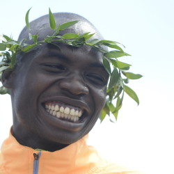 Stephen Kosgei Kibet of Kenya smiles after winning the Beach to Beacon 10K Saturday.