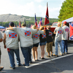 "The ""Flyin' Em High"" group from Loganville wear shirts and hang flags while participating in a pro-Confederate flag rally at Stone Mountain Park in Stone Mountain, Ga., on Saturday."