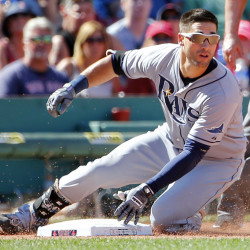 Tampa Bay Rays' Kevin Kiermaier slides into third base with a triple against the Boston Red Sox during the seventh inning of a baseball game at Fenway Park in Boston, Sunday, Aug. 2, 2015. (AP Photo/Winslow Townson)