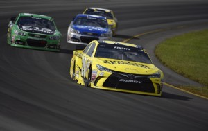 Matt Kenseth (20) drives through Turn 3 during the Pocono 400 on Sunday in Long Pond, Pa. Kenseth won the race.