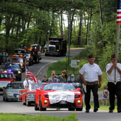 A parade makes its way down Lake View Drive toward the village of Smithfield during a celebration to mark the town's 175th anniversary on Sunday.