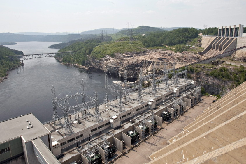In this June 2010 photo, the Jean-Lesage hydro electric dam generates power along the Manicouagan River north of Baie-Comeau Quebec. Critics of proposals to import relatively clean hydropower from Quebec into the Northeastern United States worry that transmission lines will despoil the natural beauty of places like New Hampshire's White Mountains. Others fear over-reliance on it will stymie efforts to trim consumption and develop renewable energy sources closer to home.