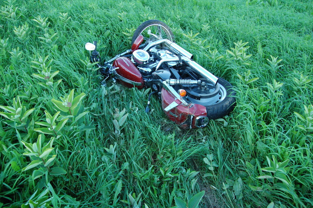 The Harley-Davidson ridden by Jonathan Billings, of Windham, Sunday lies in a field in New Sharon where Billings crashed. Billings, 24, was killed in the accident, one of four motorcyclist deaths in the state over the weekend and 17 since the beginning of the year. There were six road fatalities in all in Maine between Friday and Sunday.