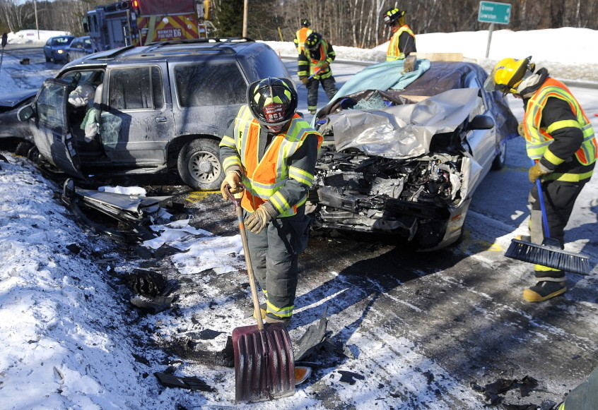 Monmouth firefighters collect debris from a two car collision that killed a woman last year on Route 202 in Monmouth.