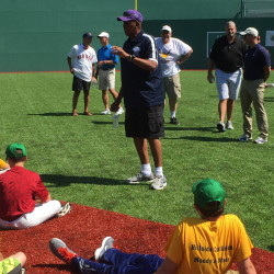 Staff photo by Travis Lazarczyk   Major League Baseball Hall of Famer Ferguson Jenkins talks to players Monday at Harold Alfond Fenway Park at Camp Tracy.