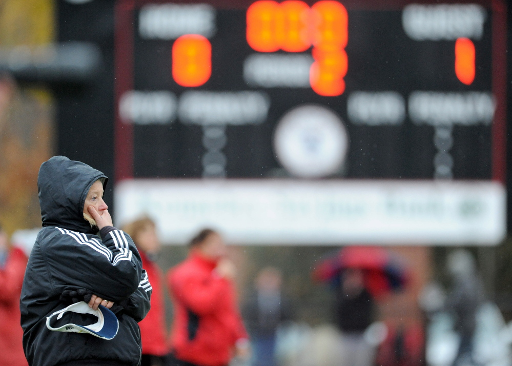 Staff file photo by Michael G. Seamans   Skowhegan Area High School field hockey head coachPaula Doughty watches as her team plays Scarborough in the Class A state title game last November. Doughty says the mandatory hands-off period is essential for players, coaches and families.