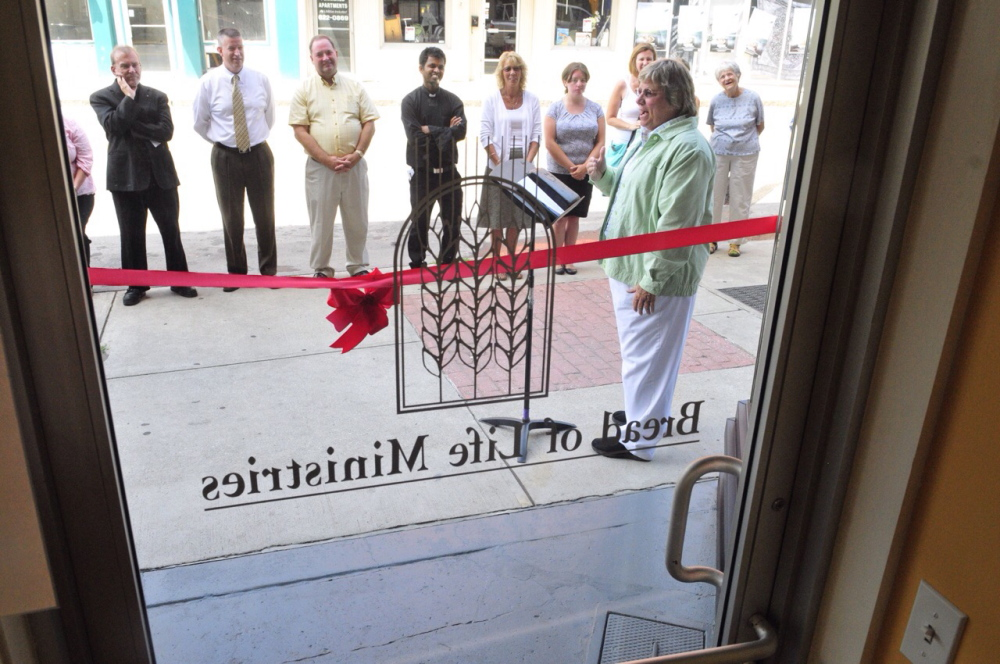 The Rev. Carolyn Neighoff, who founded Bread of Life, speaks Tuesday at a ribbon cutting for the group's new Water Street office in Augusta.