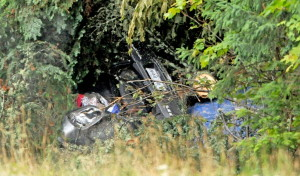 The scene on U.S. Route 201 Tuesday, where Martin Poulin and Francine Dumas, both of Quebec, were found dead in their car in West Forks Planttion. The couple had been missing since they left Quebec for a wedding a week ago. Police said the car hit a tree and it fell, blocking the accident from sight.