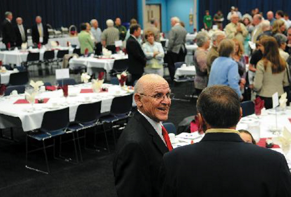 "Harold ""Tank"" Violette greets well-wishers during the Maine Sports Hall of Fame banquet in 2011. Violette, one of three Winslow football coaches since 1958, died Tuesday."