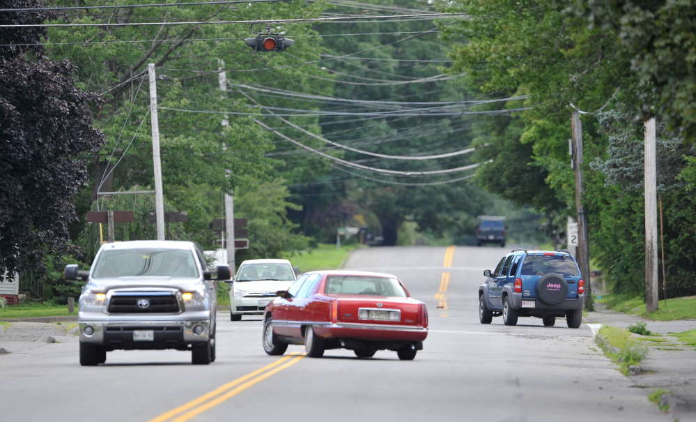 Cars travel on First Rangeway at the five-way intersection at Western Street on Wednesday. The city plans to make it a four-way intersection, but the bids came in so high the work won't be done this year ar planned.