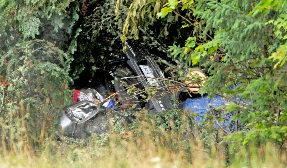 The bodies of Martin Poulin and Francine Dumas, both 58 and recently married, were found in this wreckage on U.S. Route 201 in West Forks Plantation by Poulin's son and daughter Tuesday, one week after they crossed the border from Quebec. Family members had been looking for the couple since they didn't return to Quebec Thursday.