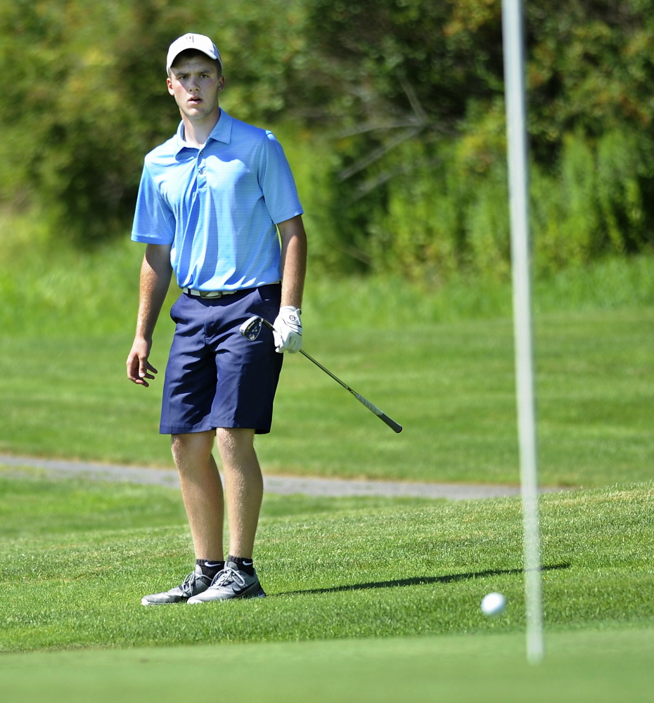 Carter Pearl of Newport watches as his chip shot almost goes in on the 13th hole during the first day of Maine Junior Golf Championship at Toddy Brook Golf course in North Yarmouth.