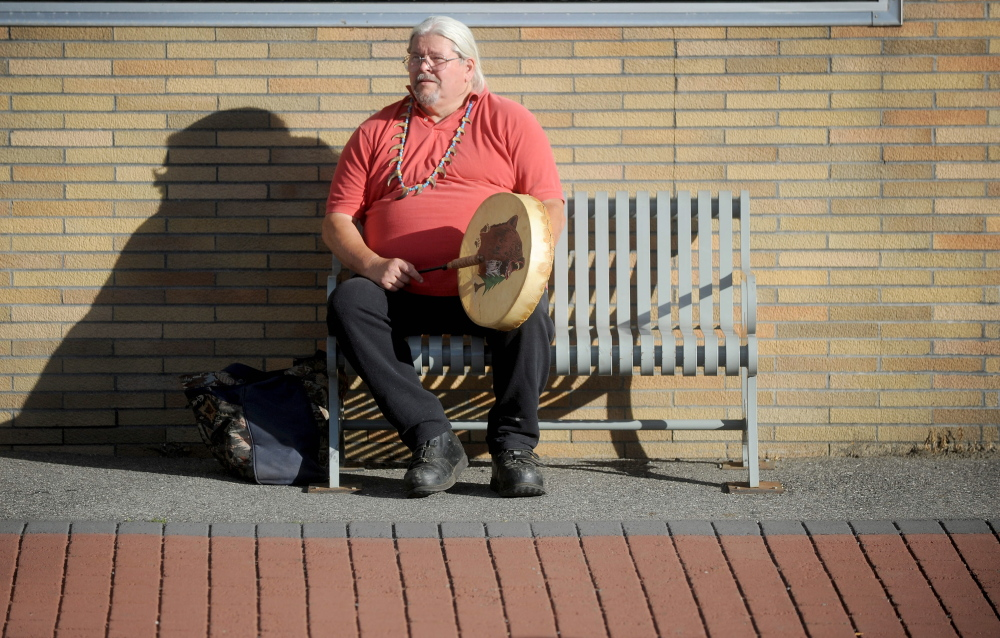 Mike Walton, of Clinton, plays his drum Thursday during a Native American rally at the Moonlight Madness festival on Water Street in Skowhegan.