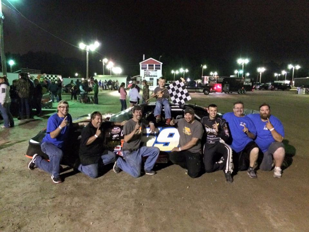 The team of Manchester's Reid Lanpher celebrates after a recent win at Beech Ridge Motor Speedway in Scarborough.