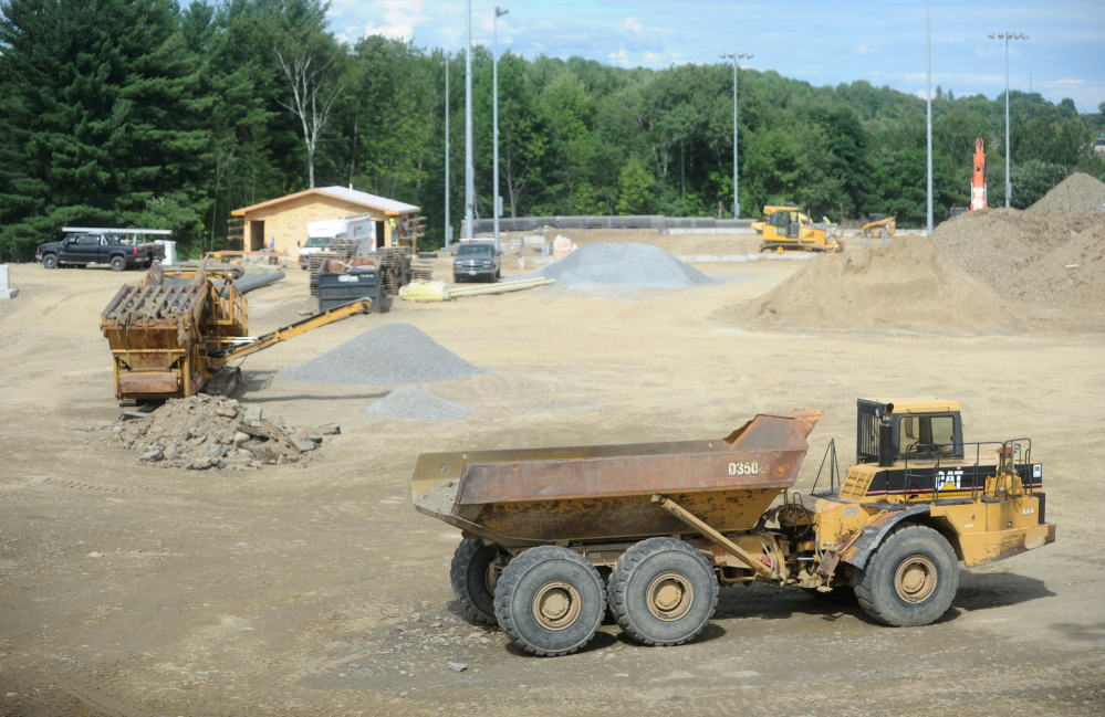 Construction crews work on the new baseball and softball complex Thursday at Colby College in Waterville.