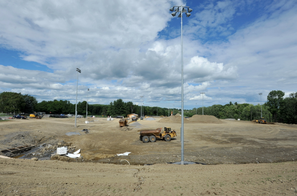 Construction crews work on the new baseball and complex Thursday at Colby College in Waterville.