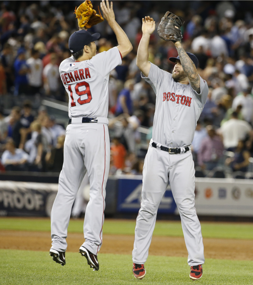 Boston Red Sox first baseman Mike Napoli, right, was traded Friday to the Texas Rangers for a player to be named later or cash.