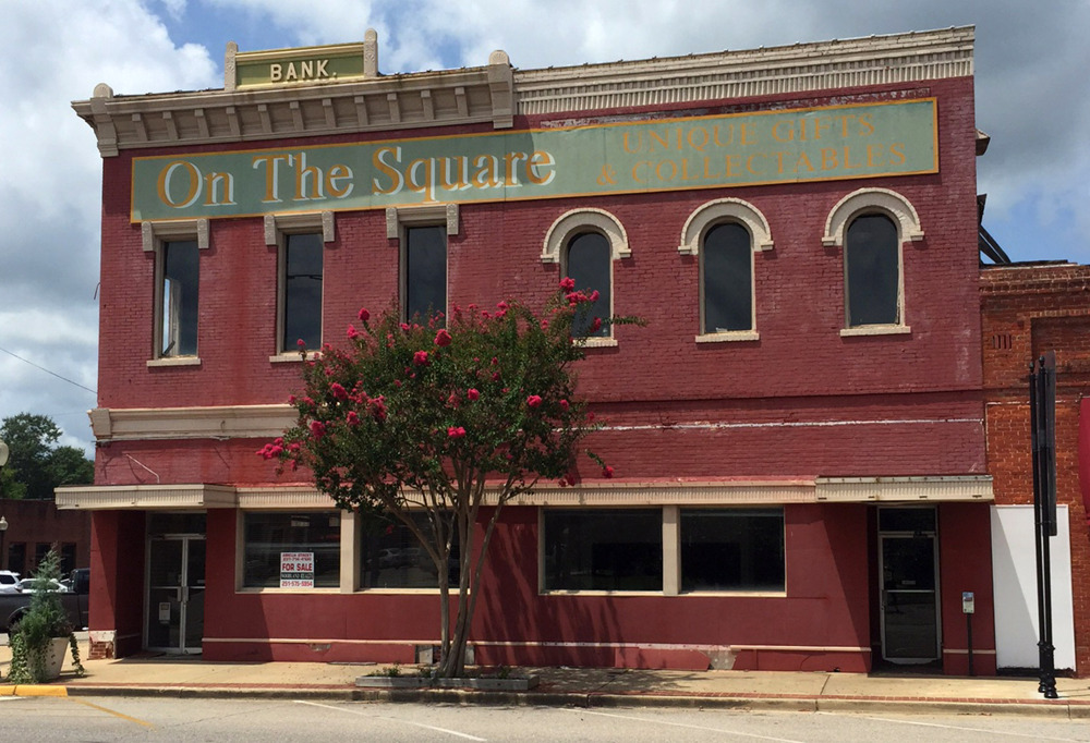 This Aug. 6, 2015, shows the old bank building that once housed the office of author Harper Lee's father A.C. Lee on the courthouse square in Monroeville, Ala.