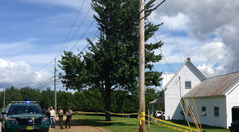 Authorities investigate the scene of multiple deaths at a home in Berlin, Vt., on Saturday.