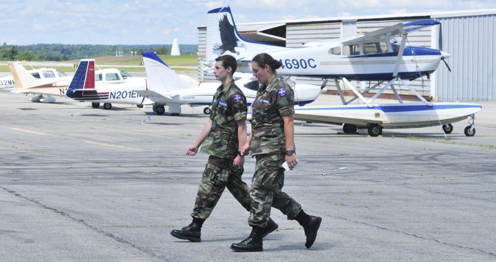 Civil Air Patrol Cadet Airman Damien Jackson, left, practices marching under direction from Cadet 2nd Lt. Veronica Wood on Saturday at the Augusta State Airport.