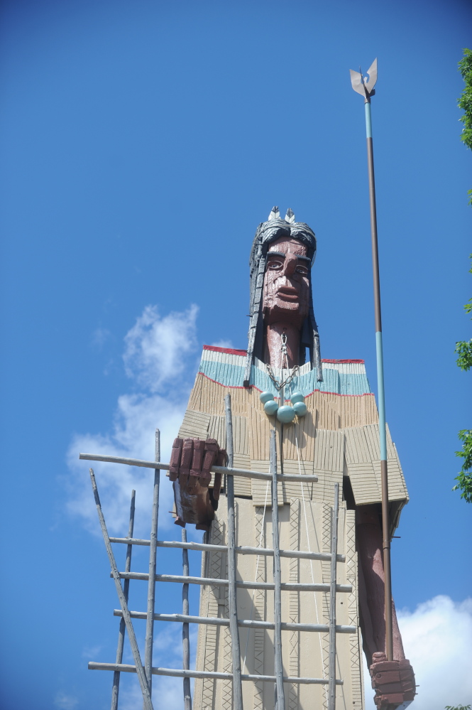 The iconic Indian sculpture created by noted local artist Bernard Langlais stands tall during a dedication ceremony Saturday for Langlais Park, which was built recently around the sculpture in Skowhegan.