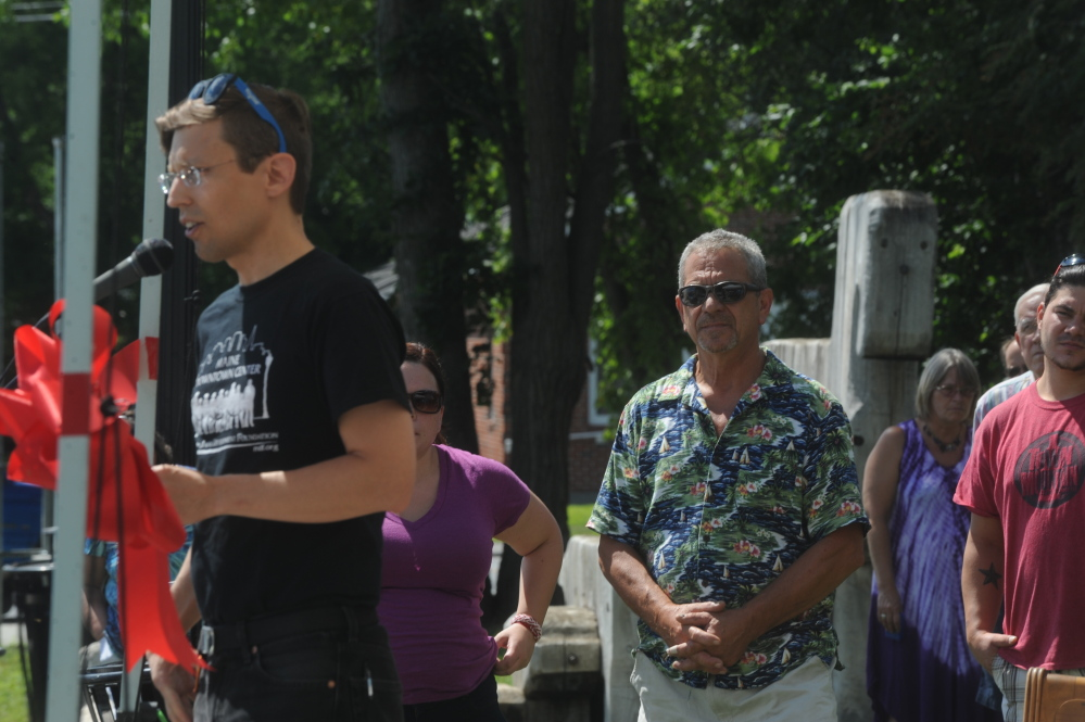 Dugan Murphy, left foreground, introduces James Langlais, younger brother of artist Bernard Langlais, on Saturday during a ceremony held to dedicate Langlais Park in Skowhegan. Bernard Langlais created the giant Indian sculpture that stands in the park.