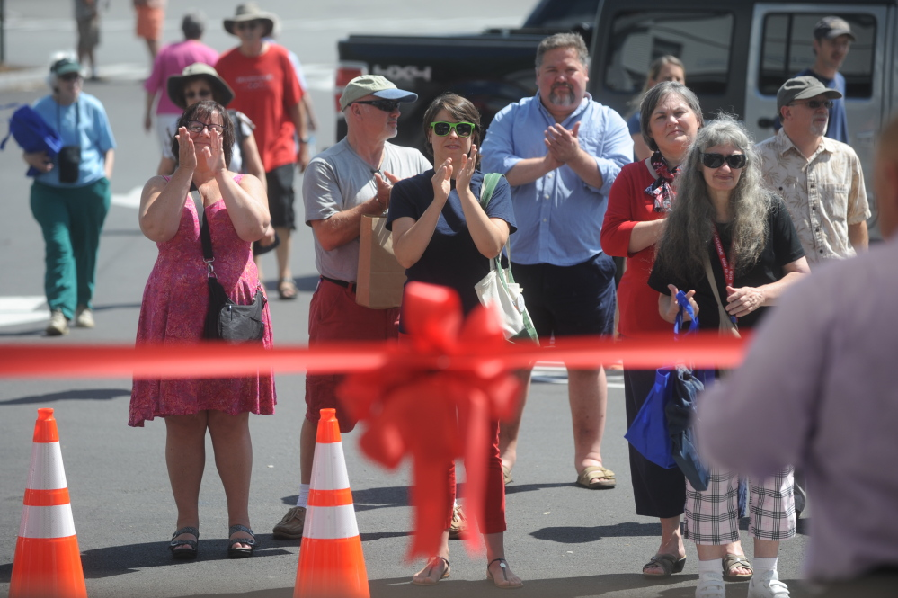 People celebrate on Saturday during a ribbon-cutting ceremony at the dedication of Langlais Park in Skowhegan.