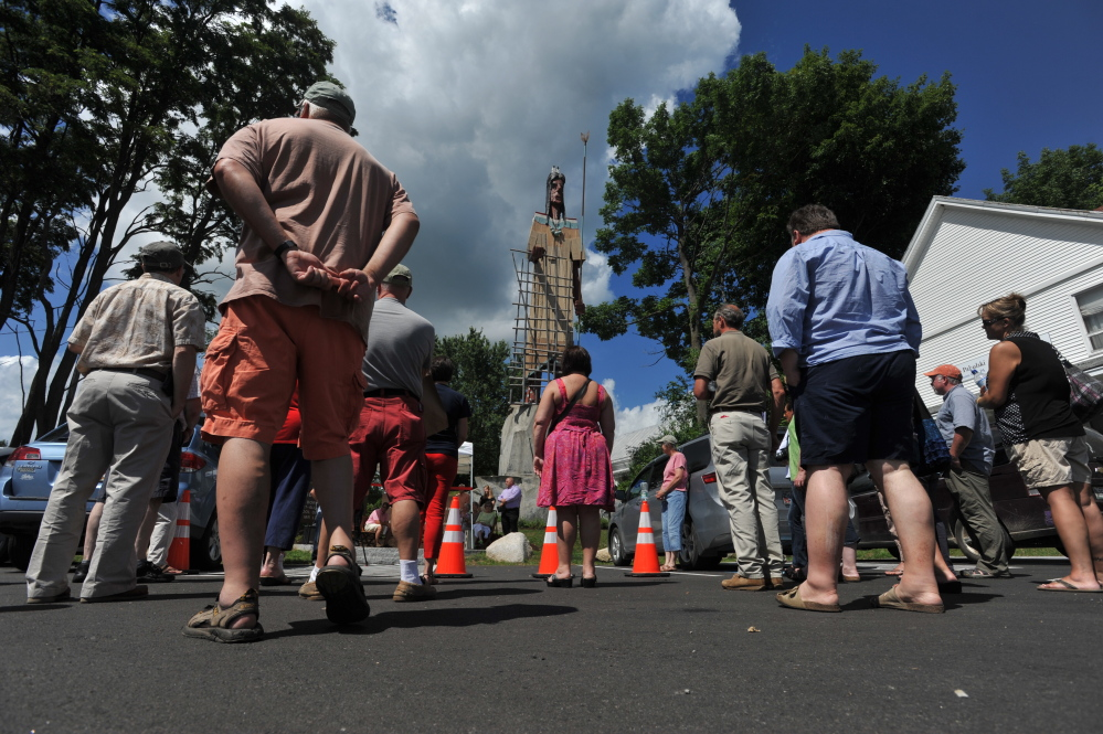 People gather at the new Bernard Langlais Park on Saturday during a ceremony dedicating the new Skowhegan park, the centerpiece of which is the 1969 Bernard Langlais Indian sculpture.