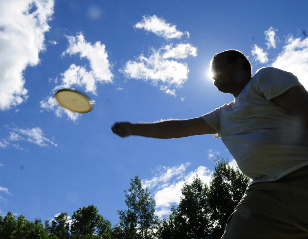 Nick Boulette takes a practice toss on the driving range before league play at DND Disc Golf on Thursday in Sidney.