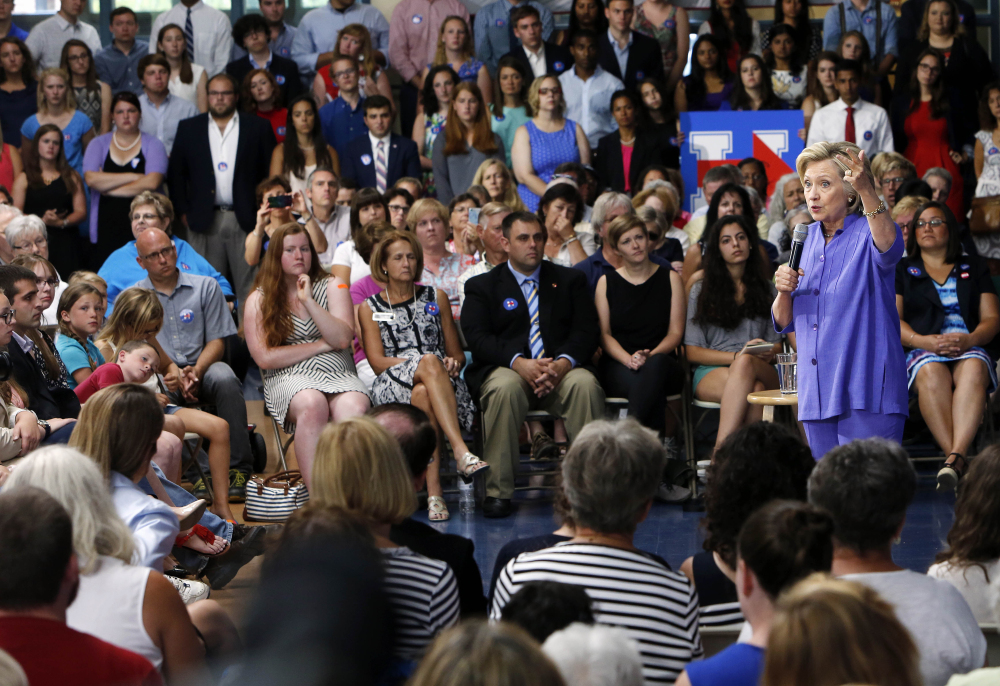 Democratic presidential candidate Hillary Clinton answers questions Monday after announcing her college affordability plan in Exeter, N.H.