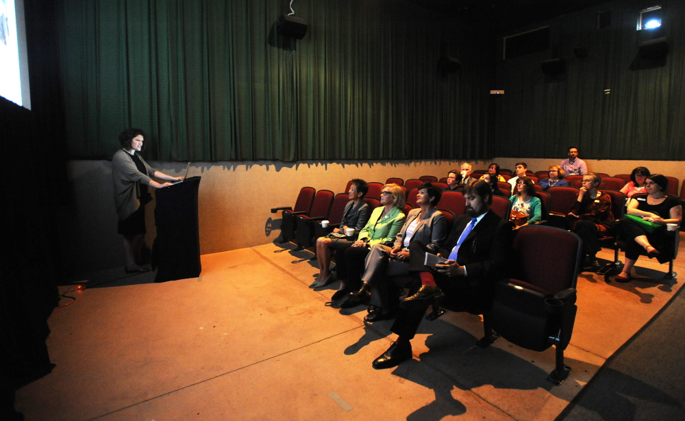 Jane Chu, chairman of the National Endowment of the Arts, left, sits with Rep. Chellie Pingree, left center, Julie Richards, executive director of the Maine Arts Commission, right center, and Nate Rudy, executive director of Waterville Creates!, during a presentation by Shannon Haines, executive director of the Maine Film Center and executive director of the Maine International Film Festival, at Railroad Square cinemas in Waterville on Tuesday.