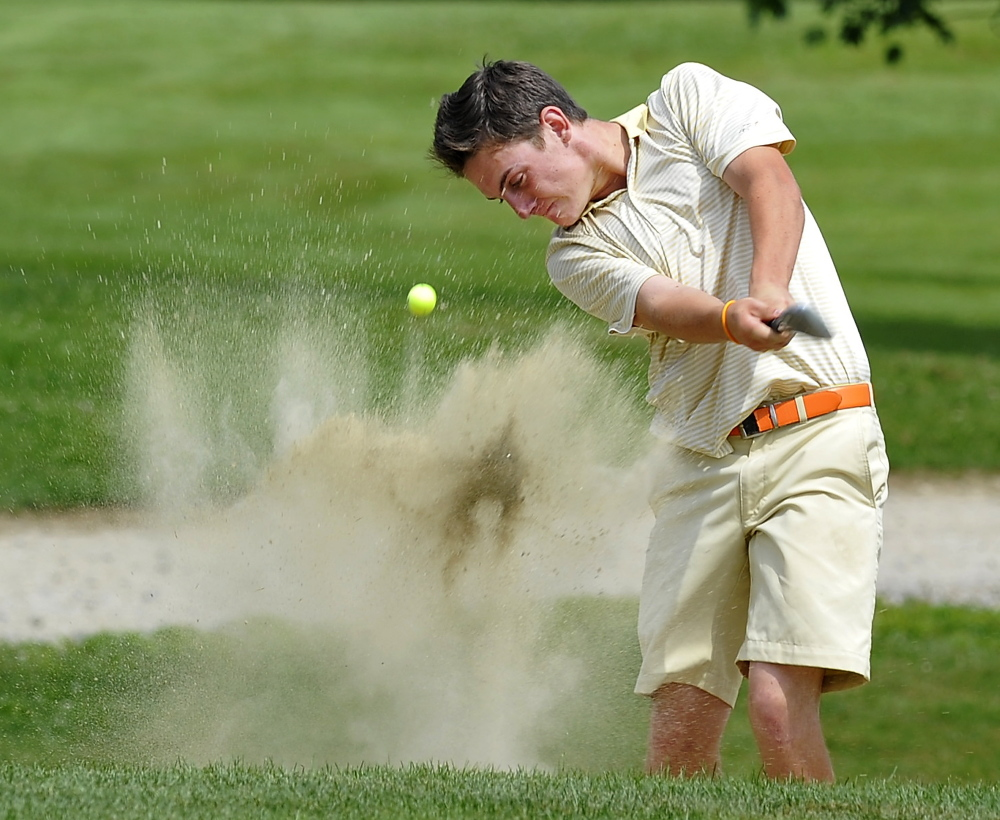 Portland Press Herald file photo by Gordon Chibroski   In this August 6, 2014 photo, Luke Ruffing, of Manchester, blasts out of the green-side bunker on the 18th hole of the Maine Junior Amateur Golf Championship at Val Halla Golf and Recreation in Cumberland Center.