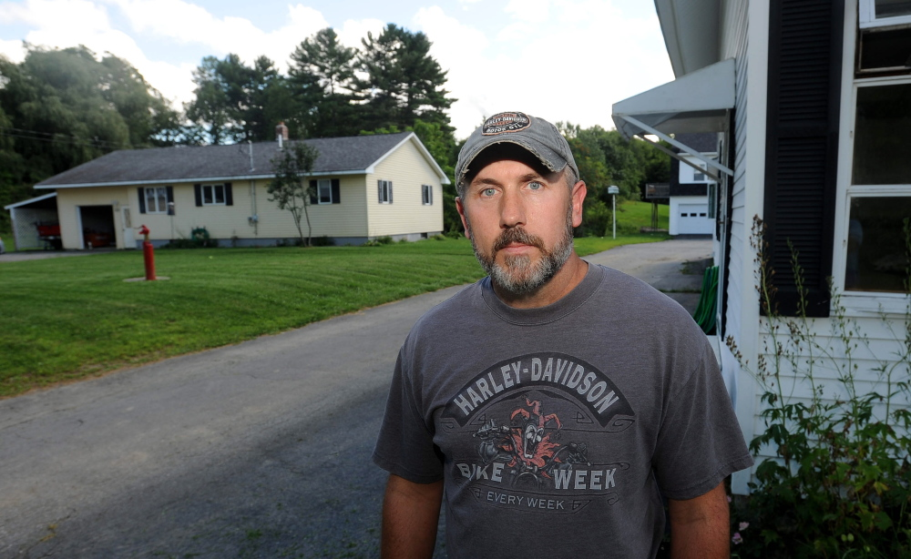 Eric Cyr, who owns a home adjacent to the site of the proposed cellphone tower, is concerned about the health effects of radio frequency radiation.