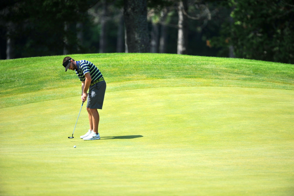 Staff photo by Michael G. Seamans In this July 7 photo, Andrew Slattery attempts a putt on the 15th hole in the first round of the Maine Amateur Championship at Waterville Country Club in Oakland. Slattery survived a 20-hole match with Joe Walp Wednesday at Martindale Country Club to advance to the finals of the Match Play Invitational.