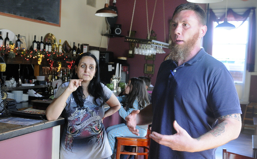 Jason McFarland discusses with his wife, Helena Gagliano-McFarland, on Wednesday in Augusta measures that must be taken to reopen the Water Street restaurant Gagliano's Italian Bistro.